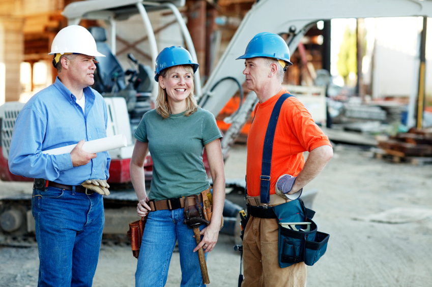 2 Male contractors and 1 Female contractor on construction site
