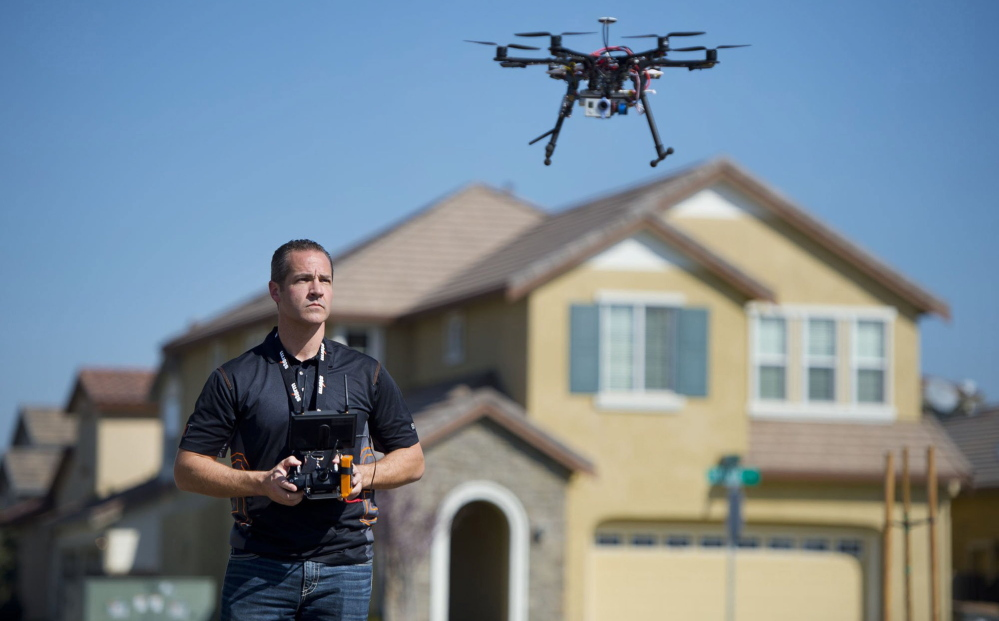 Guy using drones in real estate to show houses