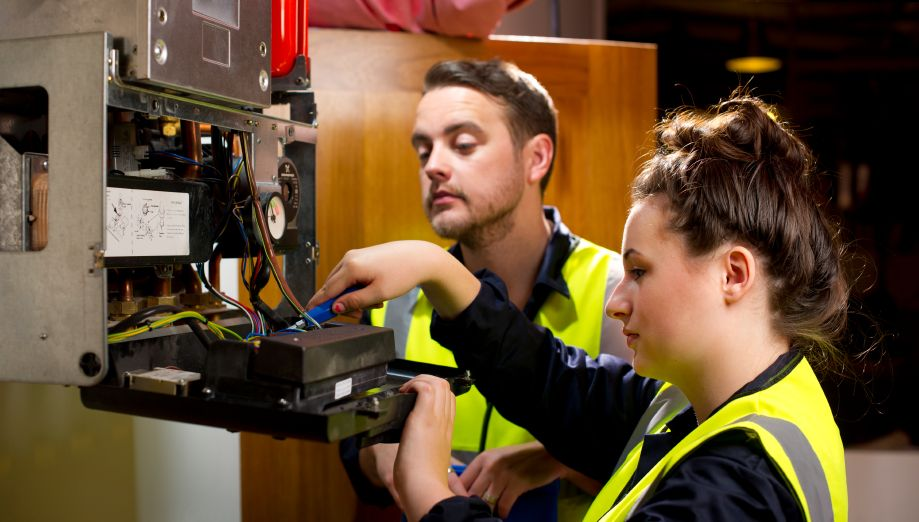 Female and Male electrician fixing faulty wiring