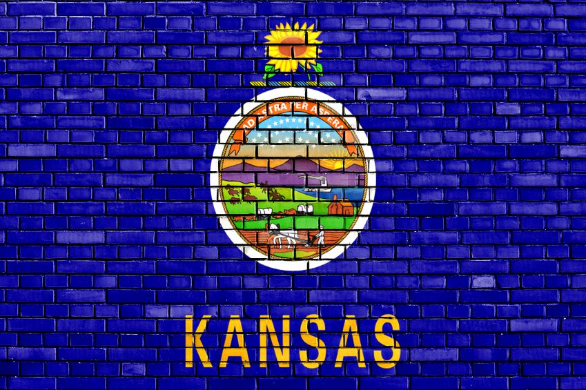 flag of Kansas painted on blue brick wall -compressor