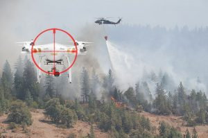 Drone with target on it with a firefighting chopper behind