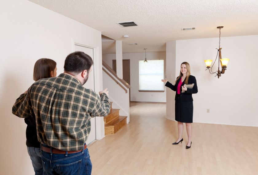 Realtor showing clients a home